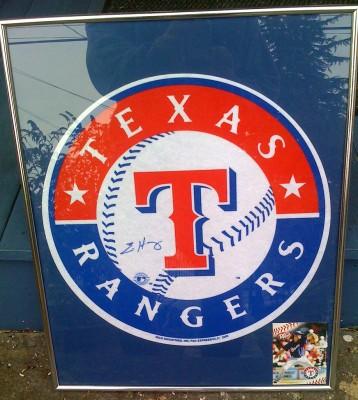 Framed Felt Texas Rangers logo, autographed by Eric Hurley